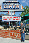 "Jeffrey N. Gildenhorn, owner of the American City Diner, 5532 Connecticut Ave, NW; Washington, DC 20015, shows his sign promoting ""The Trump Sandwich: Full of Bologna"", at the diner in Washington, DC on Tuesday, August 11, 2015.<br /> Credit: Ron Sachs / CNP<br /> (RESTRICTION: NO New York or New Jersey Newspapers or newspapers within a 75 mile radius of New York City)"