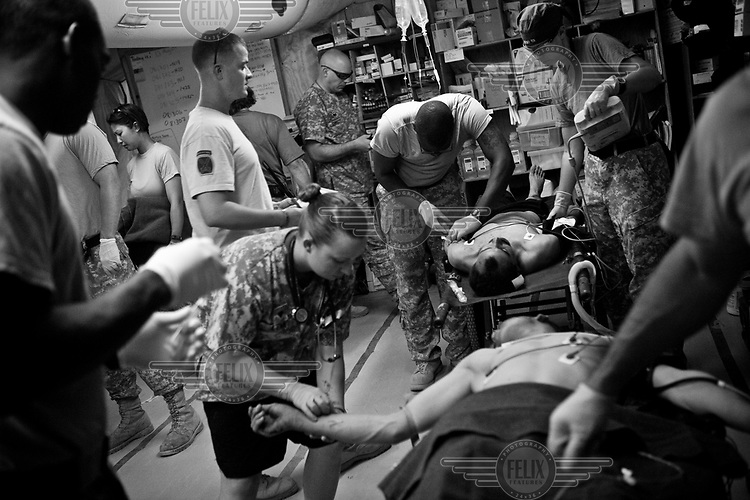 The medical staff of the 8th FST (Forward Surgical Team) treat Afghan National Army (ANA) soldiers who were injured by an IED (improvised explosive device) while on patrol close to the Forward Operating Base Shank in Logar Province. The 8th FST is the US Army's busiest trauma surgical centre, providing care for US troops, the Afghan National Army (ANA), and local civilians in Eastern Afghanistan.