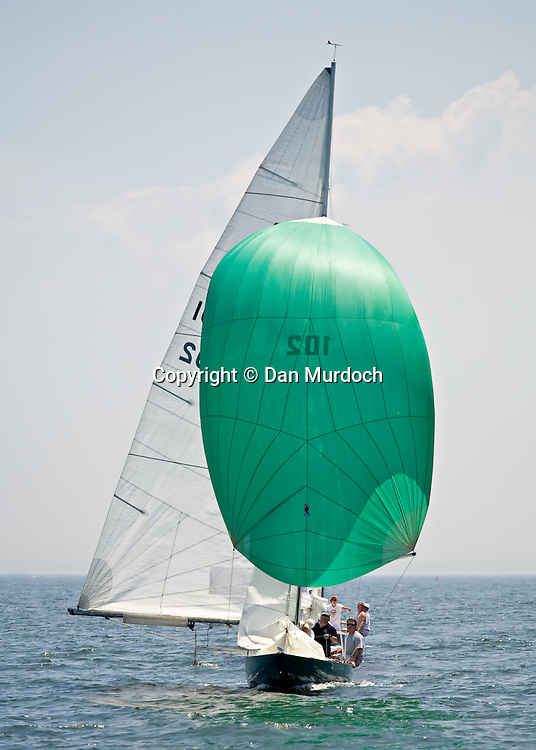 Atlantic sailboat sailing downwind with spinnaker set