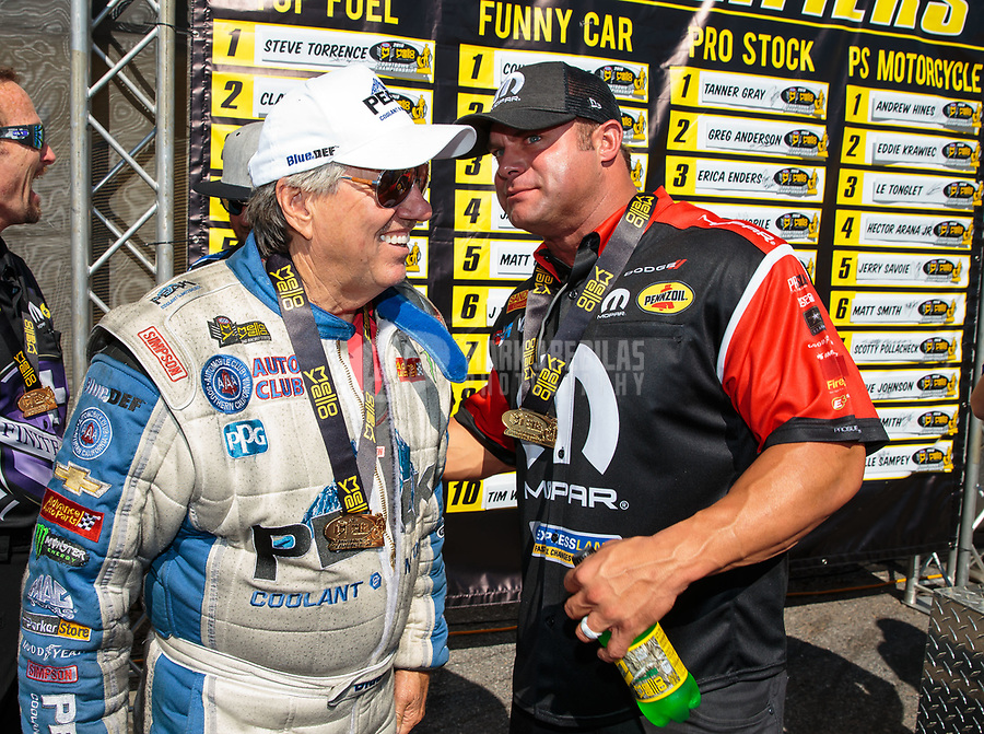 Sep 16, 2018; Mohnton, PA, USA; NHRA funny car driver John Force (left) with Matt Hagan during the Dodge Nationals at Maple Grove Raceway. Mandatory Credit: Mark J. Rebilas-USA TODAY Sports