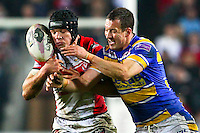 Picture by Alex Whitehead/SWpix.com - 28/03/2014 - Rugby League - First Utility Super League - St Helens v Leeds Rhinos - Langtree Park , St Helens, England - St Helens' Jonny Lomax and Leeds' Danny McGuire challenge for the ball.
