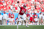 Ryan Finley (15) of the North Carolina State Wolfpack passes the ball during first half action against the South Carolina Gamecocks in the Belk College Kickoff at Bank of America Stadium on September 2, 2017 in Charlotte, North Carolina.  The Gamecocks defeated the Wolfpack 35-28.  (Brian Westerholt/Four Seam Images)