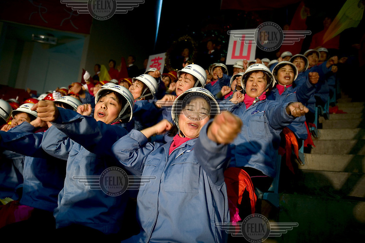 Cheerleaders from a worker's group compete in a cheerleading competition in Beijing, which is getting ready to host the 2008 Olympic Games..