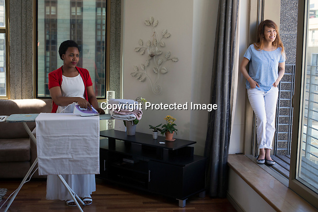 CAPE TOWN, SOUTH AFRICA NOVEMBER 22: Aisha R Pandor, the co-founder of SweepSouth inside a client's apartment while one of her domestic worker cleans the apartment on November 22, 2016 in Central Cape Town, South Africa. Many women are queuing to go through training and to work for the booming company, which has operations around South Africa, and want to expand to other African countries. (Photo by: Per-Anders Pettersson)