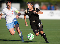 07 June 2009:  Tiffeny Milbrett of the FC Gold Pride dribbles the ball away from Lindsay Tarpley of the Red Stars during the game at Buck Shaw Stadium in Santa Clara, California.   FC Gold Pride tied Chicago Red Stars, 1-1.
