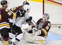 Chicago Wolves goaltender Eddie Lack (31) falls back as the puck goes into the net during the second period of an AHL hockey game against the San Antonio Rampage, Thursday, April 19, 2012, in San Antonio. (Darren Abate/pressphotointl.com)