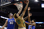 10 March 2016: Notre Dame's Zach Auguste (30) shoots a reverse layup out of the reach of Duke's Marshall Plumlee (40) and Brandon Ingram (14). The University of Notre Dame Fighting Irish played the Duke University Blue Devils at the Verizon Center in Washington, DC in the Atlantic Coast Conference Men's Basketball Tournament quarterfinal and a 2015-16 NCAA Division I Men's Basketball game. Notre Dame won the game 84-79 in overtime.