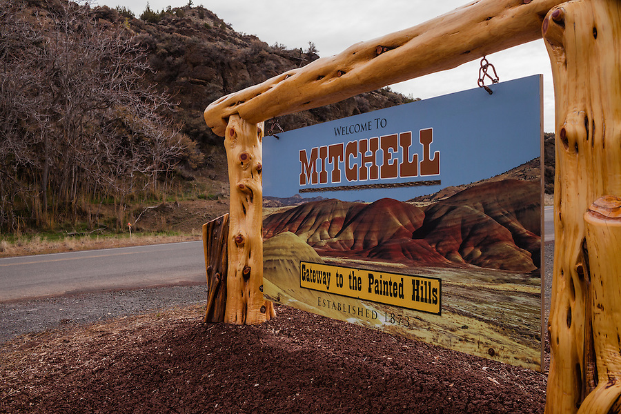 The Mitchell town sign is seen along the highway in Central Oregon's Wheeler County.