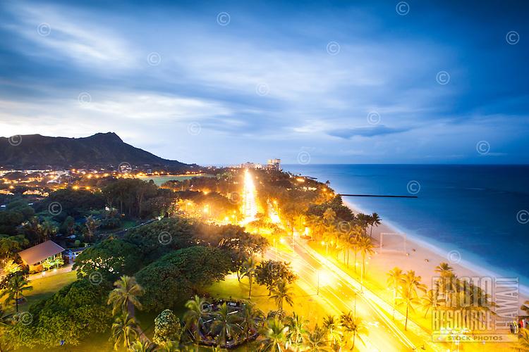 A nighttime view of Diamond Head, the Honolulu Zoo and Kalakaua Avenue, Honolulu, O'ahu.