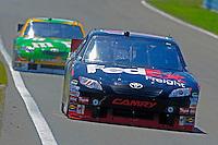 6-8 August, 2010, Watkins Glen, New York USA.Denny Hamlin (#11) and Kyle Busch (#18).©2010 F.Peirce Williams, USA.