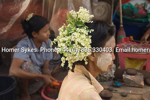 Mawlamyine or Mawlamyaing Myanmar (Moulmein Burma) 2008. Woman wearing flowers in hair, street market.