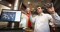 April 11 2019. San Diego, CA. USA|  Qualcomm's Staff Engineer Guilherme Brighenti talks 5G applications with cel phones. | Photos by Jamie Scott Lytle. Copyright.