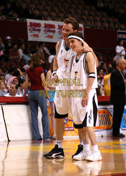 BRIAN CRANSTON & FRANKIE MUNIZ.2nd Annual Frankie Muniz HoopLA held at the Los Angeles Sports Arena in Los Angeles, California. Pokemon Trading Card Game hosts the celebrity basketball event to benefit Starlight Children's Foundation .14 March 2004.*UK Sales Only*.full length, full-length.www.capitalpictures.com.sales@capitalpictures.com.©Capital Pictures.