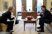 """Dr. Elizabeth """"Liz"""" Sherwood-Randall, NSC Senior Director for European Affairs and NSC Chief of Staff Mark Lippert confer in the Oval Office while President Barack Obama talks on the phone with a foreign leader 2/16/09..Official White House Photo by Pete Souza"""