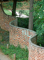 Historical serpentine walls line a driveway behind the lawn and rotunda at the University of Virginia in Charlottesville, Va. .  Photo/Andrew Shurtleff