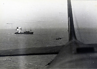 BNPS.co.uk (01202 558833)<br /> Pic:  Tooveys/BNPS<br /> <br /> Taken on 18/09/41 - A daylight attack on shipping.  An enemy tanker burns following a direct hit.<br /> <br /> Dramatic photos showing a series of heart-pounding World War Two bombing raids from the pilot's perspective have come to light.<br /> <br /> They were taken from Blenheim bombers undertaking attacks on targets in Germany and Nazi-occupied Netherlands in 1941.<br /> <br /> Several capture the immediate aftermath of a direct hit, with flames and clouds of smoke signifying they had achieved their aim.<br /> <br /> The album, which contains almost 100 photos, has emerged for sale with Toovey's Auctions, of Washington, west Sussex.