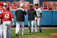 Dartmouth Big Green head coach Bob Whalen (2) and assistant coach Jonathan Anderson (11) shake hands with Elvis Dominguez after a game against the Bradley Braves on March 21, 2019 at Chain of Lakes Stadium in Winter Haven, Florida.  Bradley defeated Dartmouth 6-3.  (Mike Janes/Four Seam Images)