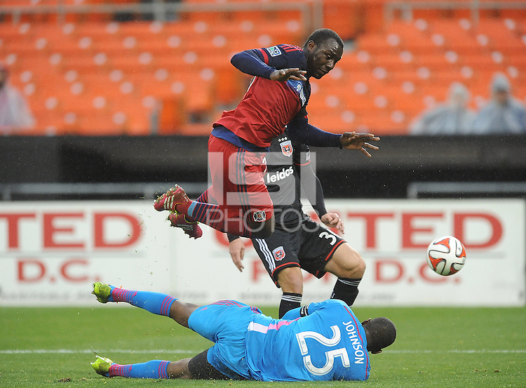 Washington D.C. - March 29, 2014: Jhon Kennedy Hurtado of the Chicago FIre collides with goalkeeper Sean Johnson of the Chicago Fire.  The Chicago Fire tied D.C. United 2-2 during a Major League Soccer match for the 2014 season at RFK Stadium.