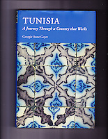 Ceramics, Sidi Bou Said, Tunisia. Old Nabeul Tiles in Local Home, Splattered with White Paint Flecks, used on a book cover. IMAGE OF COVER IS NOT FOR SALE.  Shown here as examples of photographer's portfolio.  Original images may be licensed for certain purposes.  Please inquire.