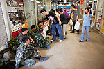 Apr. 19 2010 - BANGKOK, THAILAND: Thai civilians present food and water to Thai soldiers staged in the elevated walkways above the Silom financial district in Bangkok Monday. Hundreds of Thai soldiers, including reservists and front line units, and riot police moved into the Silom financial district Monday, not far from the red-shirts' main protest rally site, in Ratchaprasong. The heavy show of force is to prevent the Red Shirts from entering the Silom area. Many of soldiers were greeted as heros by workers in the area, who oppose the Red Shirts.   Photo by Jack Kurtz