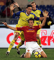 Calcio, Serie A: Roma vs Chievo. Roma, stadio Olimpico, 9 gennaio 2010..Football, Italian serie A: AS Roma vs Chievo. Rome, Olympic stadium, 9 january 2010..AS Roma forward Luca Toni, foreground, is fouled by Chievo defender Davide Mandelli..UPDATE IMAGES PRESS/Riccardo De Luca