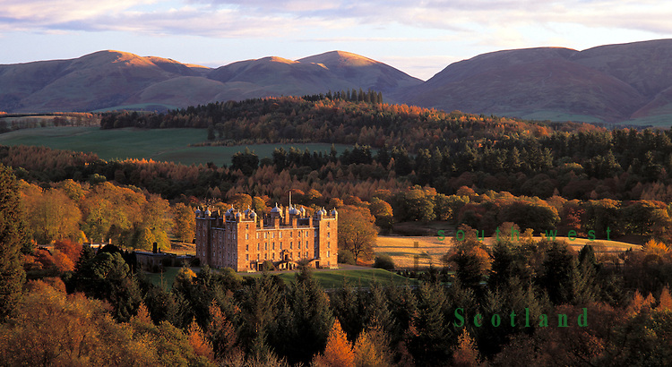 Drumlanrig Castle looking across the Nith valley to the snow topped Lowther Hills Nithsdale Dumfries and Galloway Scotland UK