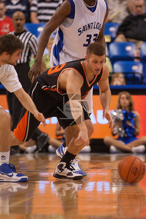 March 24,  2010                  Saint Louis guard Christian Salecich (15, left) reaches in for a ball that got loose from Princeton guard Dan Mavraides (33) in the second half.   The Saint Louis University Billikens defeated the Princeton Tigers 69-59 in a semifinal game of the College Basketball Invitational Tournament on Wednesday March 24, 2010 at the Chaifetz Arena, on the campus of Saint Louis University.  They advance in the post-season CBI Tournament and will play Virginia Commonwealth University on Monday 29, 2010 in Richmond, VA.