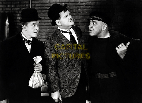 Laurel & Hardy (Stan Laurel & Oliver Hardy) With Walter Long (R).in The Live Ghost.*Filmstill - Editorial Use Only*.CAP/PLF.Supplied by Capital Pictures.