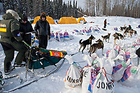 Jeff King checks in to the Eagle Island checkpoint during Iditarod 2009