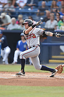 Rome Braves third baseman Jordan Egerton (13) swings at a pitch during a game against the Asheville Tourists on July 25, 2015 in Asheville, North Carolina. The Braves defeated the Tourists 3-2. (Tony Farlow/Four Seam Images)