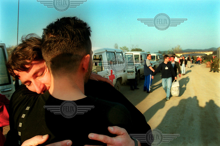 KOSOVO. Merdare, Kosovo/Serbia border. 21/04/2000..An Albanian is greeted by relatives after being released along with 30 other Albanian men and women from Pozrevac prison in Serbia..©Andrew Testa