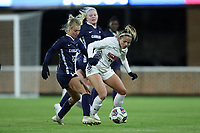 CHAPEL HILL, NC - NOVEMBER 16: Julie Garst #15 of Belmont University is challenged by Alexis Strickland #12 of the University of North Carolina during a game between Belmont and North Carolina at UNC Soccer and Lacrosse Stadium on November 16, 2019 in Chapel Hill, North Carolina.