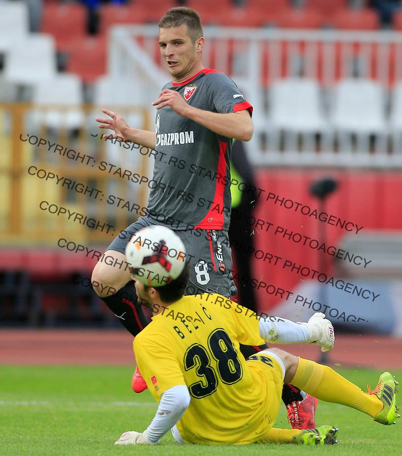 Fudbal Jelen Super League season 2014-2015 <br /> Donji Srem v Crvena Zvezda<br /> Darko Lazovic (L) scores the goal near goalkeeper Nemanja Belic<br /> Novi Sad, 29.04.2015.<br /> foto: Srdjan Stevanovic/Starsportphoto&copy;