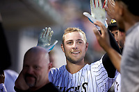 Matt Skole (21) of the Charlotte Knights is congratulated by his teammates after hitting a home run against the Toledo Mud Hens at BB&T BallPark on April 23, 2019 in Charlotte, North Carolina. The Knights defeated the Mud Hens 11-9 in 10 innings. (Brian Westerholt/Four Seam Images)