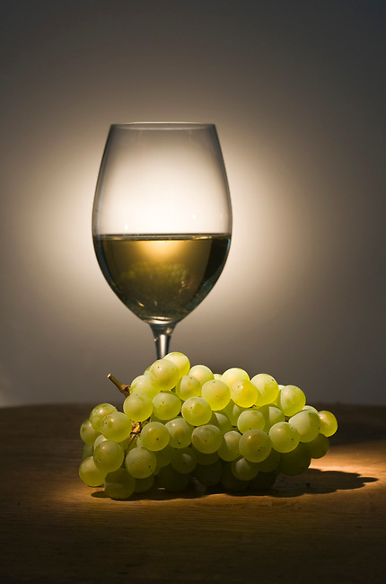 Chardonnay wine and grapes