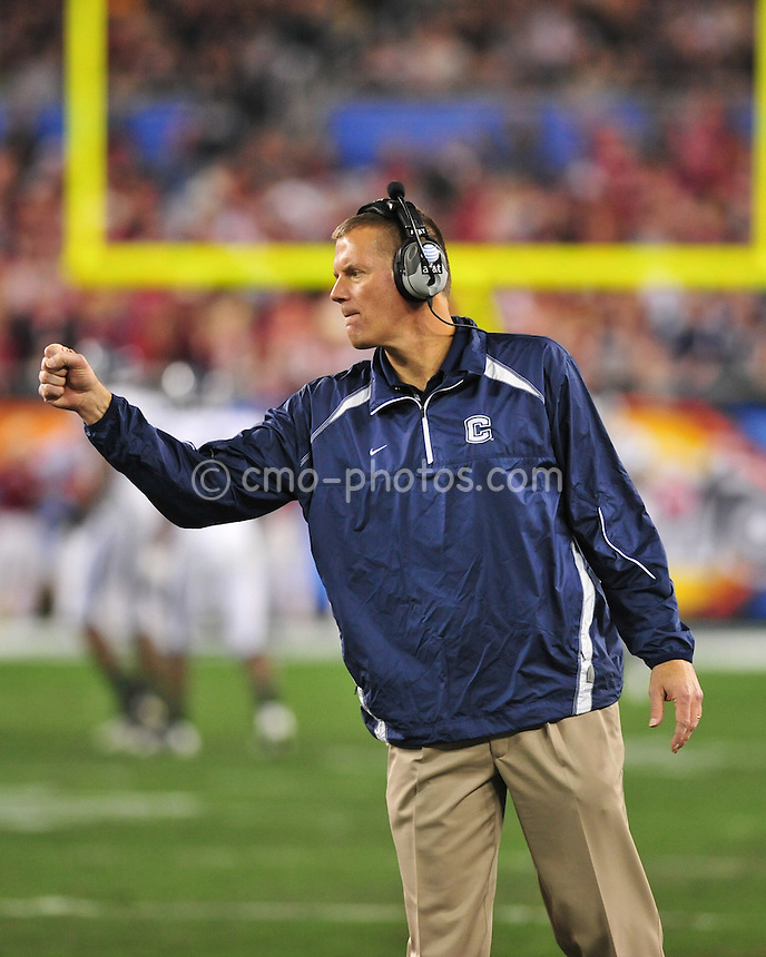 Jan 1, 2011; Glendale, AZ, USA; Connecticut Huskies head coach Randy Edsall congratulates kicker Chad Christen (13) in the 1st quarter of the 2011 Fiesta Bowl against the Oklahoma Sooners at University of Phoenix Stadium.  The Sooners won the game 48-20.