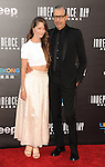 Jeff Goldblum and date at the Independence Day Resurgence Premiere held at the TCL Chinese Theatre, Los Angeles CA. June 20, 2016.