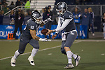 Nevada quarterback Carson Strong (12) hands off to running back Toa Taua (35) in the first half of an NCAA college football game against New Mexico in Reno, Nev., Saturday, Nov. 2, 2019. (AP Photo/Tom R. Smedes)