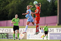 Becky Sauerbrunn (22) of the Washington Freedom heads the ball as Kacey White (20) of Sky Blue FC can only watch. Sky Blue FC and the Washington Freedom played to a 4-4 tie during a Women's Professional Soccer match at Yurcak Field in Piscataway, NJ, on July 15, 2009.