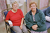 Woman waiting with friend in accident and emergency department of hospital,
