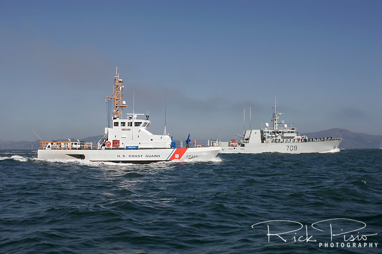 United States Coast Guard cutter Tern and Canadian  coastal defence vessel HMCS Nanaimo (MM702) in formation on San Francisco Bay.
