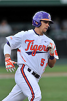Center fielder Chase Pinder (5) of the Clemson University Tigers runs out a ball in a game against the Wofford College Terriers on Tuesday, March 1, 2016, at Doug Kingsmore Stadium in Clemson, South Carolina. Clemson won, 7-0. (Tom Priddy/Four Seam Images)