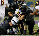 SIOUX FALLS, SD - SEPTEMBER 23: The defense from the University of Sioux Falls brings down Kevin Evans #22 from Minnesota Crookston in the first half of their game Saturday night at Bob Young Field in Sioux Falls. (Photo by Dave Eggen/Inertia)