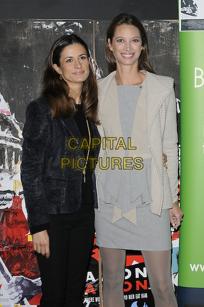 "LIVIA GIUGGIOLI & CHRISTY TURLINGTON BURNS .At the ""No Woman No Cry"" premiere during the 54th BFI London Film Festival, BFI Southbank, London, England, UK, October 23rd 2010..half length black jacket cream blue grey gray peplum dress tights ruffle pinstripe beige .CAP/CAN.©Can Nguyen/Capital Pictures."