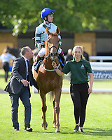 Winner of The European Bloodstock News Ebf 'Lochsong' Fillies' Handicap Belated Breath ridden by Oisin Murphy and trained by Hughie Morrison  is led into the Winner's enclosure during Racing at Salisbury Racecourse on 5th September 2019