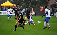 Team Wellington's Eric Molley is fouled during the Oceania Football Championship final (first leg) football match between Team Wellington and Lautoka FC at David Farrington Park in Wellington, New Zealand on Sunday, 13 May 2018. Photo: Mike Moran / lintottphoto.co.nz