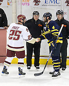 Matt Price (BC - 25), John Gravallese, Pat Bowen (Merrimack - 4), Tim Benedetto - The Boston College Eagles defeated the Merrimack College Warriors 7-0 on Tuesday, February 23, 2010 at Conte Forum in Chestnut Hill, Massachusetts.