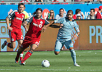 18 August 2012: Sporting KC midfielder Paulo Nagamura #6 and Toronto FC midfielder Torsten Frings #22 in action during an MLS game between Sporting Kansas City and Toronto FC at BMO Field in Toronto, Ontario Canada.