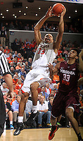 Virginia guard Justin Anderson (23) shoots over Virginia Tech forward Marshall Wood (33) during the game Tuesday in Charlottesville, VA. Virginia defeated Virginia Tech73-55.