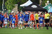 Kansas City, MO - Saturday May 07, 2016: Players walk on to the pitch before the game between Houston Dash and FC Kansas City during a regular season National Women's Soccer League (NWSL) match at Swope Soccer Village. Houston won 2-1.